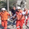 Evacuating injured in Qana Photo: Reuters