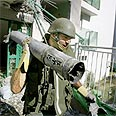 Soldier with rocket that landed in Kiryat Shmona Photo: Reuters