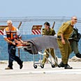 Injured soldier arriving to hospital Photo: Doron Golan