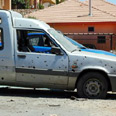 Israeli car damaged by Katyusha rocket during war Photo: Niv Calderon