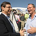 Ambassador to US Ayalon (L) and Bielski greet new immigrants at Ben-Gurion Airport Photo: Eli Elgarat
