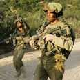 IDF withdrawing from Lebanon. Hizbullah weapons to remain along border Photo: AFP