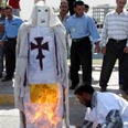Protesters burn down 'pope' doll Photo: AP