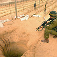 IDF soldier inspecting tunnel near Rafah Photo: AP