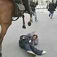 Policeman hits protestor Photo: Reuters
