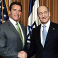 With Arnold Schwarzenegger Photo: Reuters
