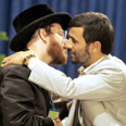 Neturei Karta member kissing Ahmadinejad Photo: AFP
