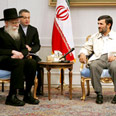 Neturei Karta rabbi meets Ahmadinejad Photo: AFP