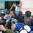Palestinians in line for paychecks (archives) Photo: AFP