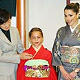 Abdallah's wife and daughter with in Japan Photo: AFP