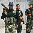 Armed Hamas loyalists in Gaza Photo: AP