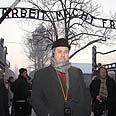 MK Barakeh in Auschwitz. 'Embodiment of human evil' Photo: Itzik Harari, Knesset