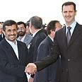 Big smiles in Damascus – Assad and Ahmadinejad Photo: AFP