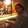 Curator Adolfo Roitman shows two parts of ancient Biblical manuscript Photo: AP
