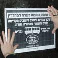 Sign hung in Jerusalem