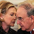 Clinton and Mideast envoy Mitchell Photo: AFP