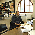 Prof. Rosenthal researching in the library