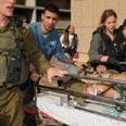 Evacuating injured soldier Photo: Herzl Yosef