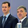 Mutual interests. Assad and Gul Photo: AFP