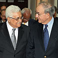 Abbas (L) and Mitchell during proximity talks Photo: AFP