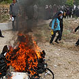 Palestinians burning israeli products in protest Photo: AP