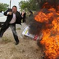 Palestinians burning Israeli products (archives) Photo: AP