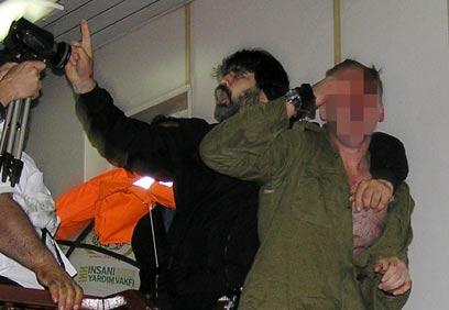 IDF soldier assaulted on Marmara (Photo: AFP)