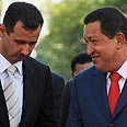 Assad (L) and Chavez (archives) AFP