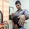 Tehran barber demonstrates proper haircut