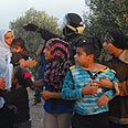 Children watch as houses razed Photo: Herzl Yosef