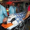 Evacuating injured to hospital Photo: Herzel Yosef