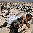 Gravel collectors at work Photo: AP