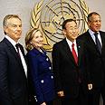 Clinton with UN officials Photo: AFP
