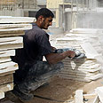 A Palestinian laborer building after freeze lifted (archive) Photo: AFP