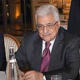 'Get involved.' Abbas in Paris, Sunday Photo: AFP