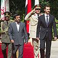 Iran's Ahmadinejad and Syria's Assad Photo: Reuters