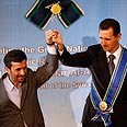 Iran's Ahmadinejad with Syria's Assad (Archives) Photo: AP