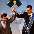 Iran's Ahmadinejad with Syria's Assad (Archives) Photo: AP