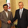 Best buddies – Ahmadinejad and Suleiman Photo: AFP