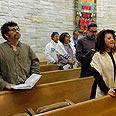 'Added vigilance.' Prayer service at Chicago shul Photo: AP