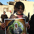 Girl holding Abu Rahma's picture Photo: Gil Yohanan