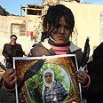 Girl holding Abu Rahma's picture Photo: Gil Yohanan