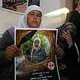 Jawaher Abu-Rahma 's mother with picture of dead daughter Photo: Gil Yohanan