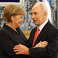 Peres praises Merkel for her stand on Iran Photo: Gil Yohanan