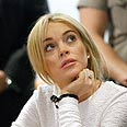 Lindsay Lohan in court. Tweeting away Photo: AP