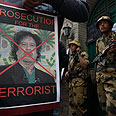 Poster condemning leader Photo: AP