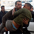Wounded Palestinian evacuated Photo: Reuters