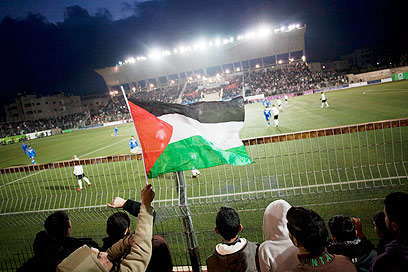 Crowds watch team 'Palestine' play Thailand near Ramallah (Photo: AP)