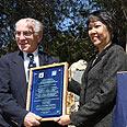 Abassador Garcia receives merit certificate Photo: Gili Mazza