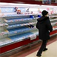 Empty shelves in Japanese supermarket following tsunami Photo: AP